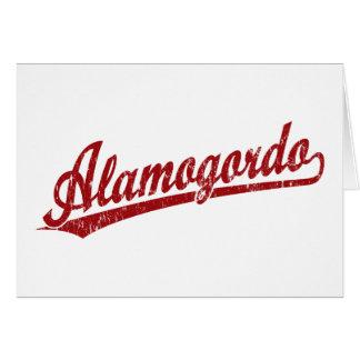 Alamogordo script logo in red card