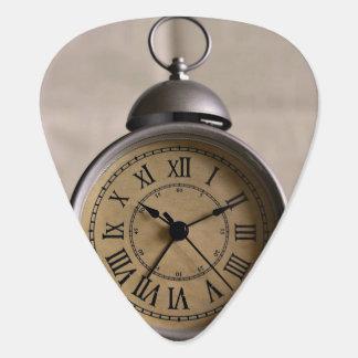 Alarm clock with roman numerals guitar pick