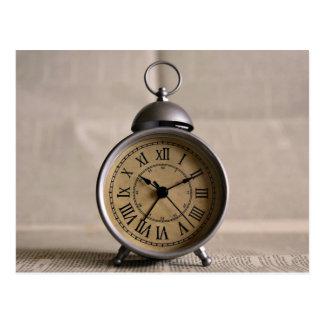 Alarm clock with roman numerals postcard