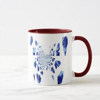 Alas azules de la mariposa taza