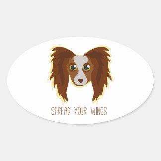 Alas del perro calcomanía ovalada