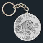 "Alaska State Quarter Keychain<br><div class=""desc"">&quot;The Great Land, &quot; features a grizzly bear emerging from the waters clutching a salmon in its jaw. The coin's design includes the North Star displayed above the inscription ""The Great Land"" and the inscriptions ""Alaska"" and ""1959."" The quarter&#39;s engraver:  Charles Vickers. The source image thanks to US Mint.</div>"