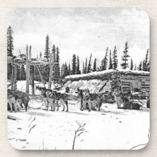 Alaskan Sled Dogs Standing Outside a Log Cabin Drink Coaster