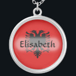 """Albania Flag   Name Necklace<br><div class=""""desc"""">The design for this attractive pendant features a name overlying the Albanian flag,  which has been neatly morphed to fit the round shape. The featured name can be changed to any name or text of your choice,  creating a personalized gift for someone who loves Albania. &#169; 2011 FlagAndMap</div>"""