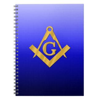 Albañil masónico con el azul de la pendiente cuaderno