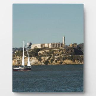 Alcatraz Island and a Lone Sailboat Display Plaques