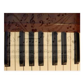 Alegría, llaves del piano y notes_ de la música tarjeta postal
