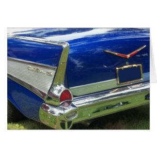 Aleta 1957 y defensa posteriores de un azul chevy tarjeta de felicitación