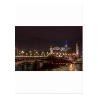 Alexander bridge and large palace At night Paris Postcard