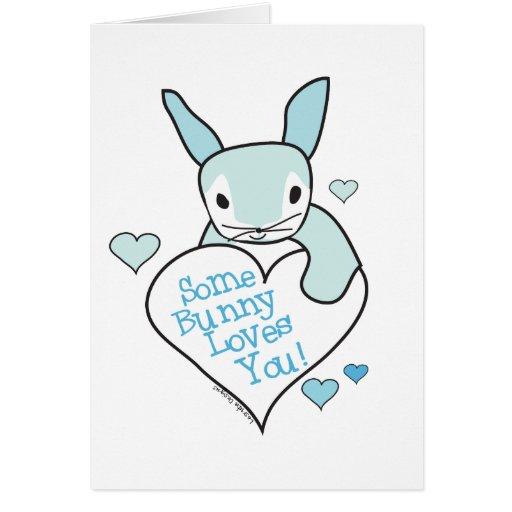Algún conejito le ama los regalos tarjeta de felicitación