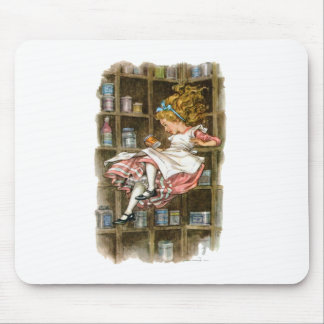 Alice floats down the rabbit hole mouse pad