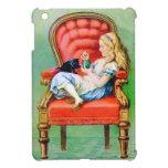 Alicia y el Dinah el gato en la silla roja grande