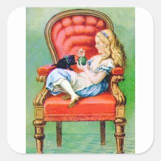 Alicia y su gato Dinah en la silla roja grande del Calcomanías Cuadradass
