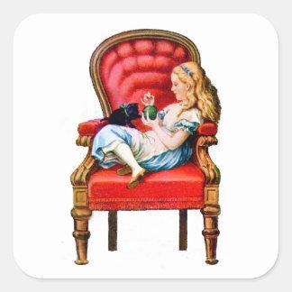 Alicia y su gato Dinah en la silla roja grande Calcomanías Cuadradases