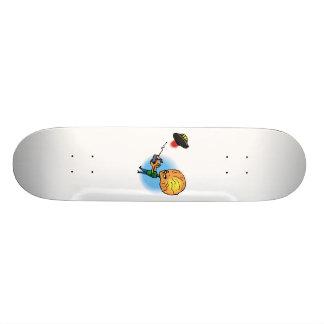 Alien boy with toy flying saucer skateboard deck