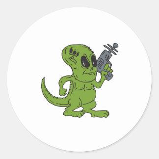 Alien Dinosaur Holding Ray Gun Cartoon Round Stickers