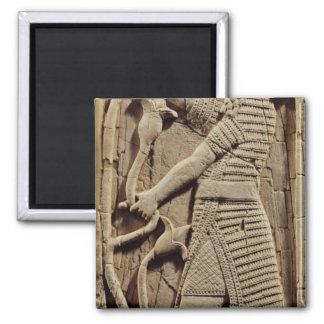 Alivio que representa a un guerrero imán cuadrado
