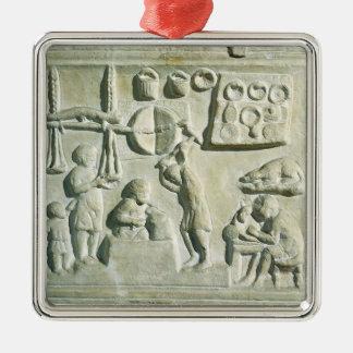 Alivio que representa el interior de una fragua adorno navideño cuadrado de metal