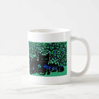 all black cat and her kittens on teal background.t coffee mug