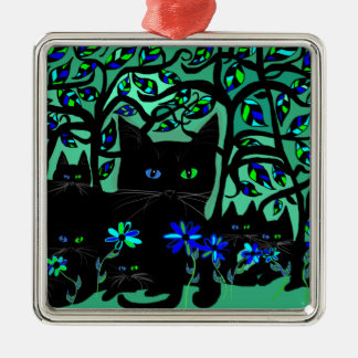 all black cat and her kittens on teal background.t metal ornament