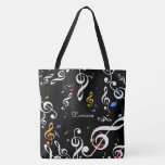 "all_over tote bag of musical notes with name<br><div class=""desc"">A personalized music themed design with treble clefs and some other color musical symbols on black</div>"