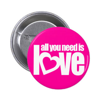 """all you need is love"" button badge in pink white"