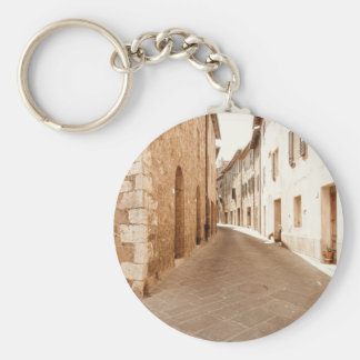 Alley in old Tuscany village . Pienza, Italy Keychain