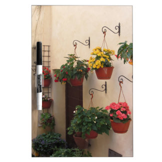Alley with flowers in old village of Spello, Italy Dry-Erase Board