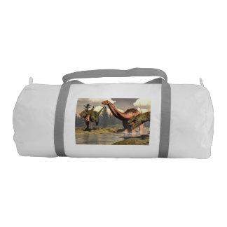 Allosaurus hunting big brontosaurus dinosaur gym bag