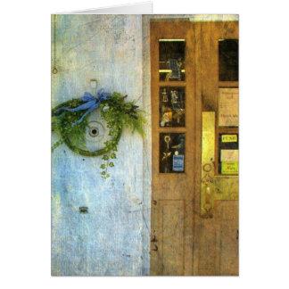 Almacene la puerta principal y enrruelle tarjeta de felicitación