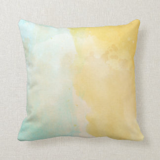 Almohada amarilla blanca en colores pastel de la