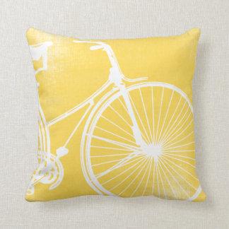 Almohada amarilla y blanca de la bicicleta