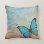 Almohada azul del vintage de la mariposa
