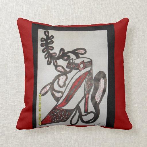 Almohada coloreada con un talón rojo