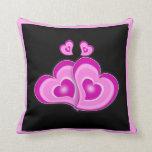 Almohada de tiro rosada de los corazones