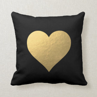Almohada negra del corazón del oro