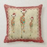 Almohada roja festiva de Mojo de las jirafas