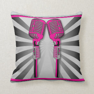 Almohada rosada de los micrófonos gemelos del
