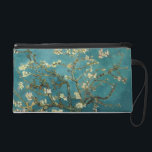 """Almond Blossoms Arles Wristlet<br><div class=""""desc"""">Almond Blossom by Vincent van Gogh Almond Blossom was painted in 1890 in honor of a special event in Vincent&#39;s life. On January 31, Vincent&#39;s brother Theo and his wife Johanna had a son, and they named him Vincent Willem. Vincent painted this branch of blossoming almond in celebration of the...</div>"""