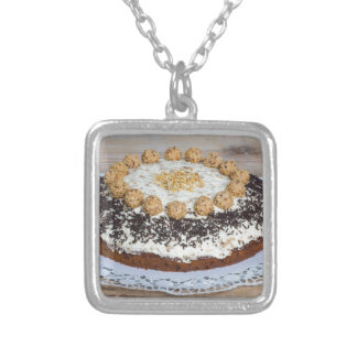 Almond nut cake on rus silver plated necklace