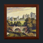 "Alnwick Castle Northumberland England Gift Box<br><div class=""desc"">Wood jewelry box features an inlaid ceramic tile with a digitally cleaned and enhanced vintage illustration of Alnwick Castle in Northumberland, England by Francis Orpen Morris from 1870. Pictures the castle in the background with a bridge and river in the foreground. The earliest construction of the castle is dated to...</div>"