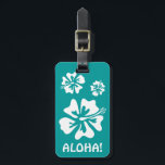 """Aloha luggage tag with Hawaiian Hibiscus flowers<br><div class=""""desc"""">Aloha travel luggage tag with Hawaiian Hibiscus flowers. Cute tropical vector design for newly weds going on Honeymoon in Hawaii. Funny Mr &amp; Mrs destination wedding gift idea. Customizable background color behind the floral. Turquoise blue and white color.</div>"""