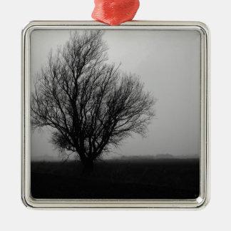 Alone in winter metal ornament