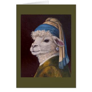 Alpaca con una tarjeta del pendiente de la perla