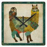 Alpaca del oro y reloj de pared del búho del trull