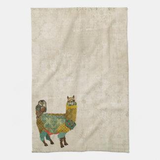 Alpaca del oro y toalla del búho del trullo