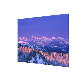 Alpenglow strikes the peaks of Glacier Canvas Print