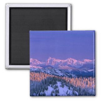 Alpenglow strikes the peaks of Glacier Fridge Magnets