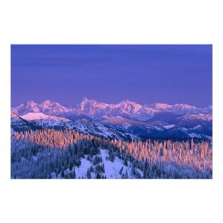 Alpenglow strikes the peaks of Glacier Photo Print