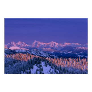 Alpenglow strikes the peaks of Glacier Poster